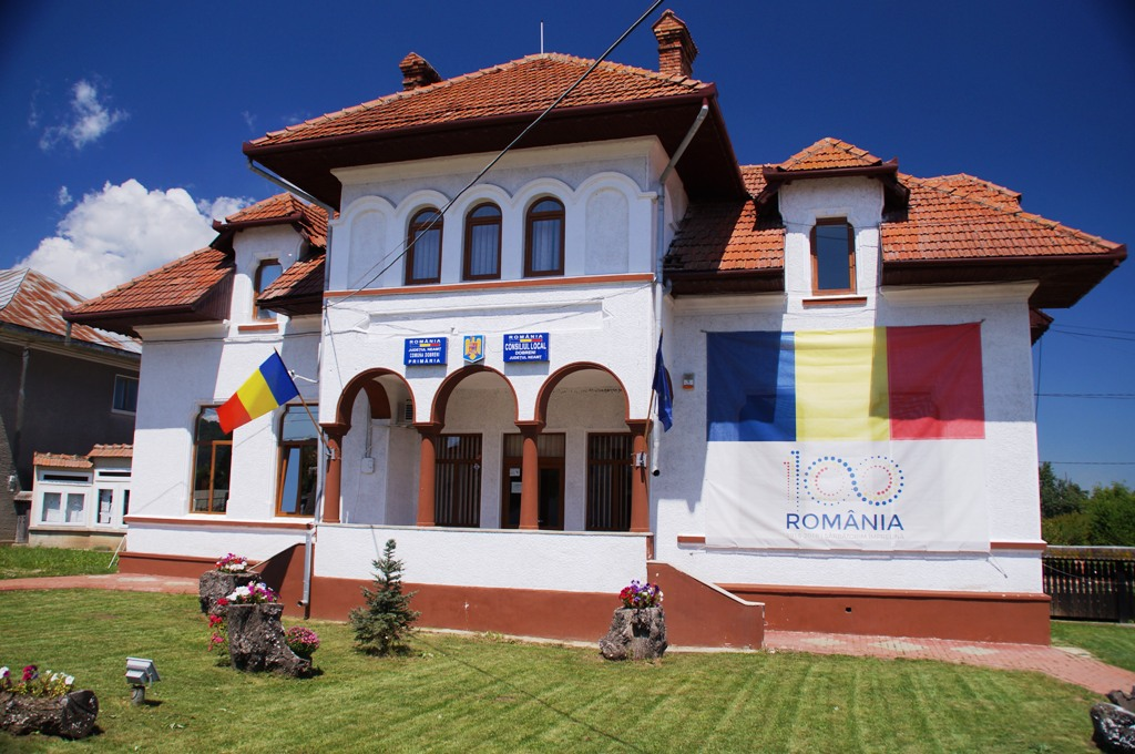 White building with Romanian flags